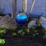 Lighting Mirror Ball In Garden logo