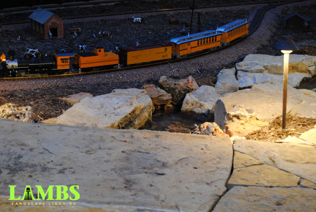 Train going by Path Light Arlington Outdoor Train